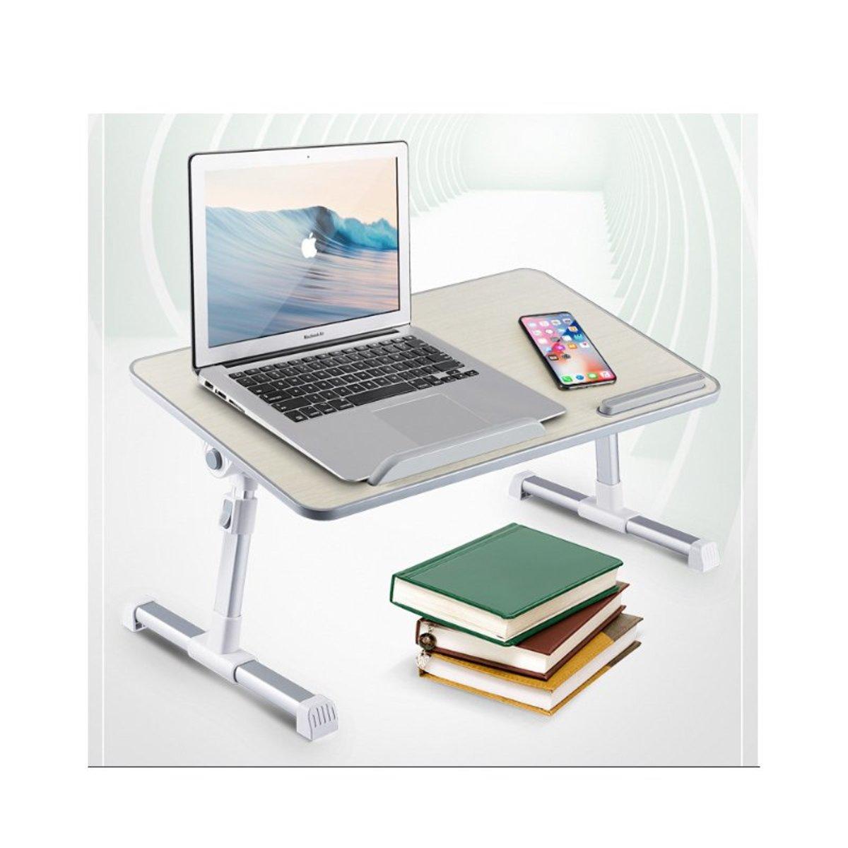 Folding computer desk on bed