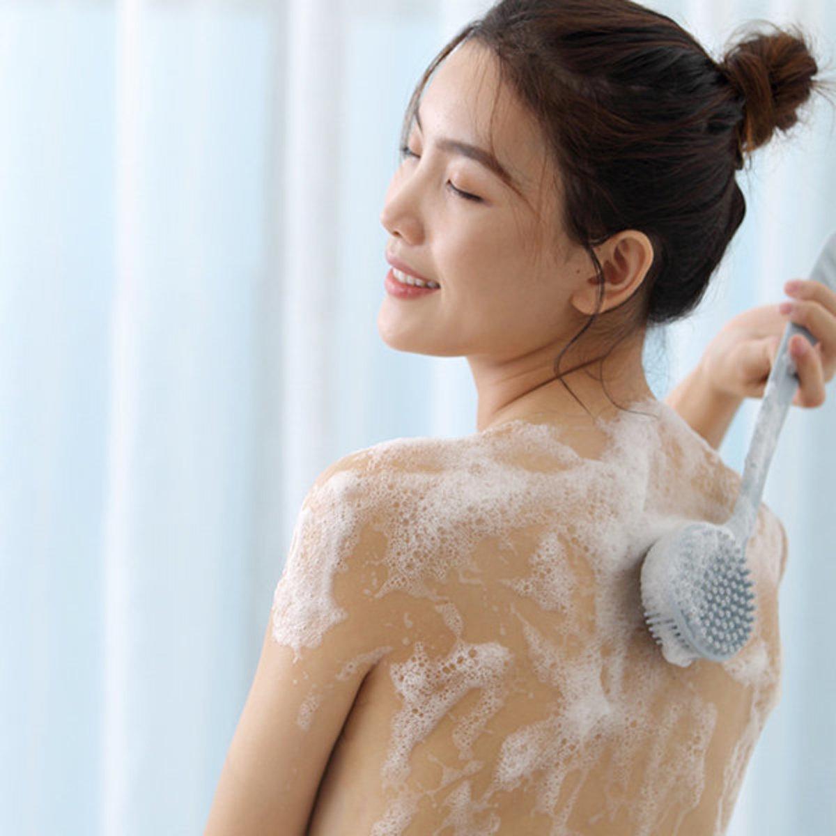 Double-sided silicone massage brush
