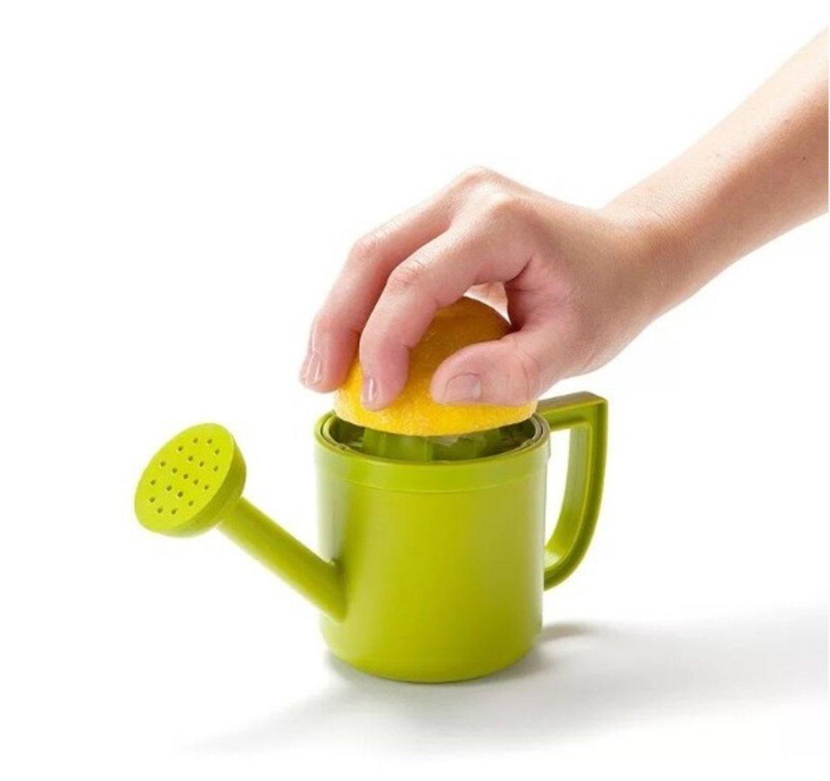 Lemon fruit hand juicing jug