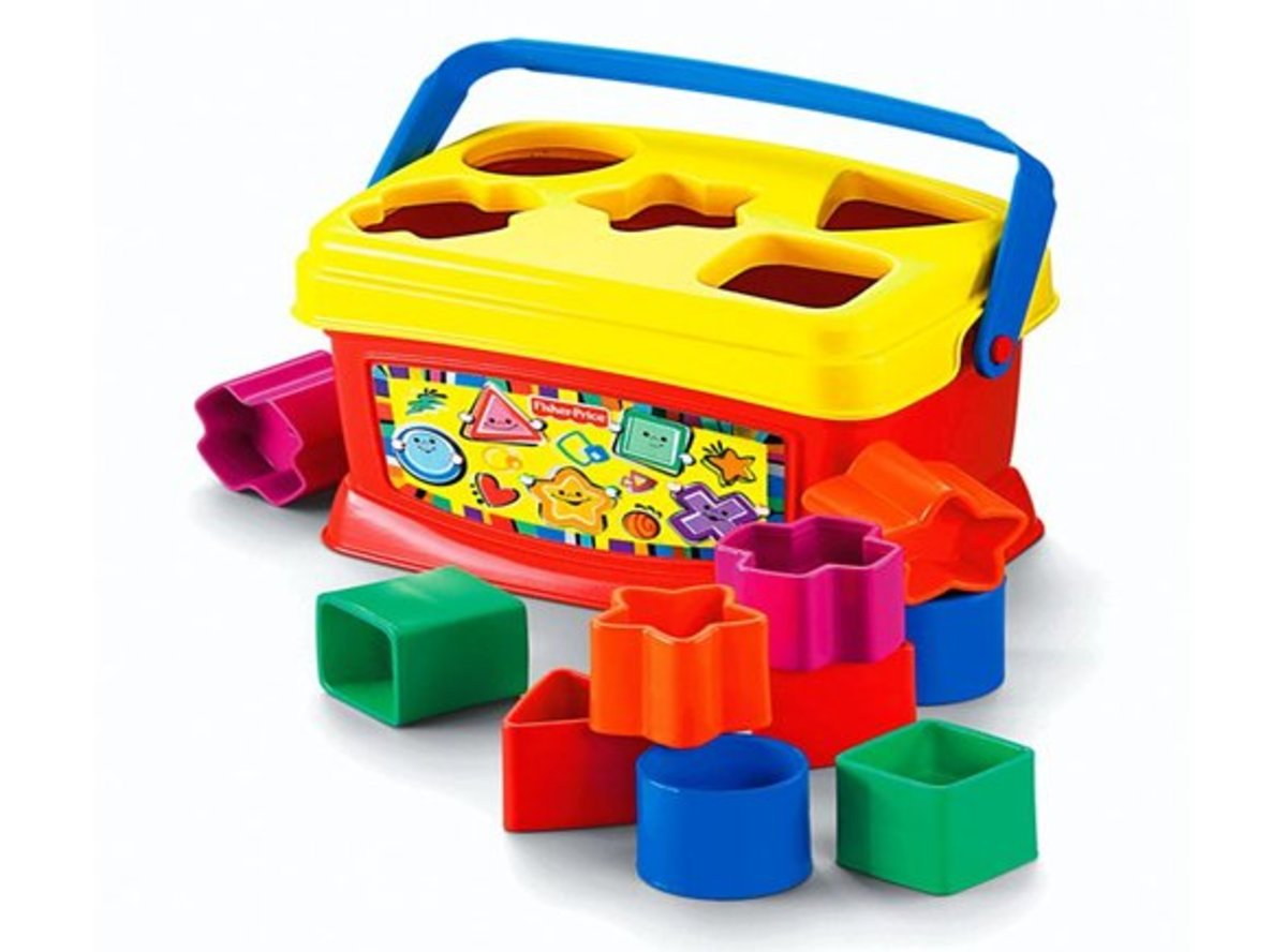 """Ten colorful blocks (and a portable block bucket) stack up to big fun…and help baby """"build"""" skills! """
